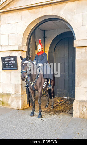 LONDON HORSE GUARDS  WITH MOUNTED CAVALRY OFFICER IN WINTER - Stock Photo