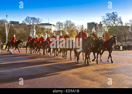 LONDON THE CHANGING OF THE GUARD AT BUCKINGHAM PALACE ON A WINTER MORNING WITH THE RED COATED  HOUSEHOLD CAVALRY - Stock Photo