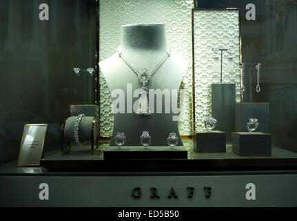 Jewelry in the shop window of Graff jewelers at Christmas time in Old Bond Street, London UK  KATHY DEWITT - Stock Photo