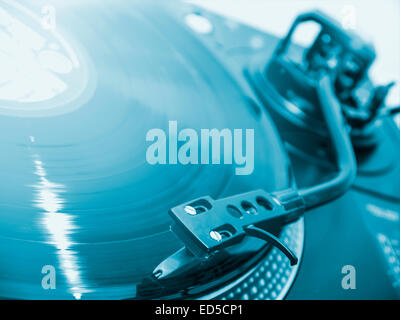 dj turntable plays music from a record - Stock Photo