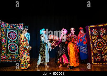 Actors in traditional Uzbek costume of 19 century perform wedding ceremony during 'Instants of Eternity' show in - Stock Photo