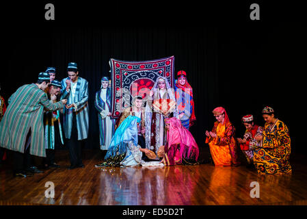 Actors in traditional Uzbek costume of 19 century perform wedding ceremony during 'Instants of Eternity' show in - Stock Photo