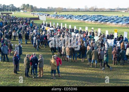 Cottenham, Cambridgeshire, UK. 28th December, 2014. Spectators crowd near the bookie stands at the Cambridgeshire - Stock Photo