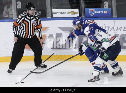 St. Petersburg, Russia. 28th Dec, 2014. Dynamo's Alexei Tsvetkov (C), SKA's Jimmie Ericsson (R) and SKA's Tony Martensson - Stock Photo