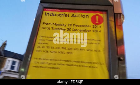 London, UK. 28 December 2014. Flyers at a bus stop along Romford road with information about delayed / canceled - Stock Photo