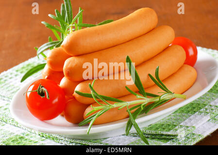 Pile of Vienna sausages on plate - Stock Photo