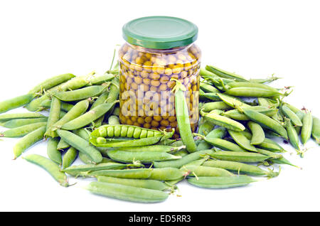 canned green pea in glass jar and fresh pods isolated on white background - Stock Photo