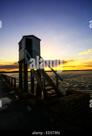 The causeway that crosses over to Lindisfarne (Holy Island) on the Northumberland coast at sunset. Northumberland Canvas. Nortrh Stock Photo