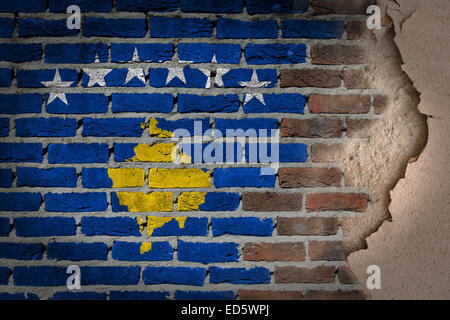 Dark brick wall texture with plaster - flag painted on wall - Kosovo - Stock Photo