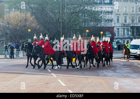Horseguards riding from Hyde Park to Horseguards Parade for the changing of the guard London - Stock Photo