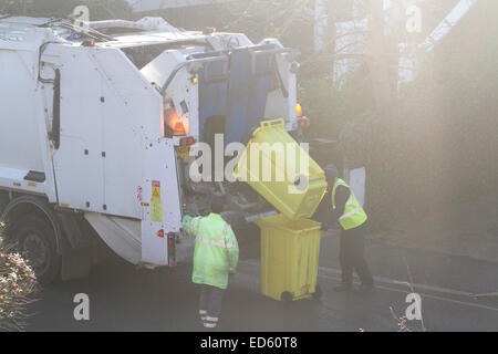 Wimbledon London,UK. 29th December 2014. Merton council bin men collect the Christmas rubbish from households to - Stock Photo