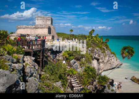 Tourists visiting ruins of the Mayan temple grounds at Tulum, Quintana Roo, Yucatan, Mexico - Stock Photo