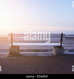 bench near the sea (norderney) in evening - Stock Photo