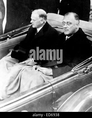 Franklin Delano Roosevelt and Herbert Hoover in convertible automobile on way to U.S. Capitol for Roosevelt's inauguration, - Stock Photo