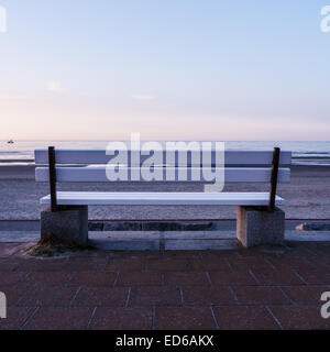 bench and the sea in evening time - Stock Photo