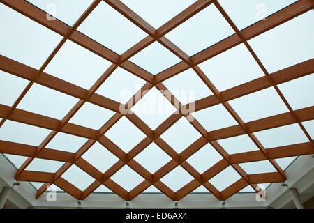 Sun-room patio area with transparent wooden ceiling - Stock Photo