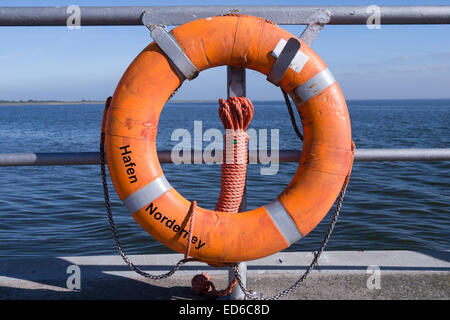 lifebelt at harbor of norderney - Stock Photo