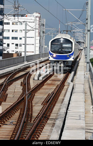 mosern high speed sky train or locomotive approaching to station - Stock Photo