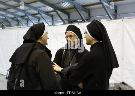 Prague, Czech Republic. 29th December 2014. Three nuns enjoy their time at the meeting. Some 30,000 young pilgrims - Stock Photo
