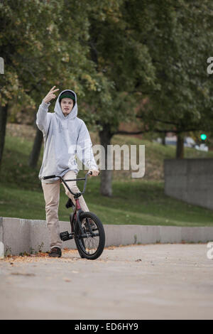 Bmx rider in concrete park in urban area - Stock Photo