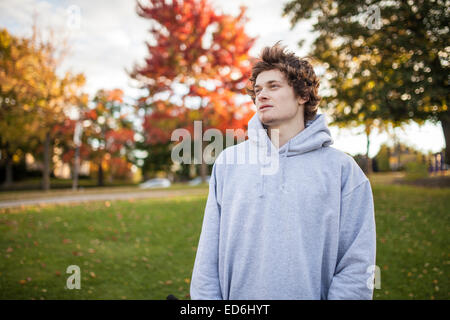 Portrait of young bmx rider in autumn with sweater on - Stock Photo