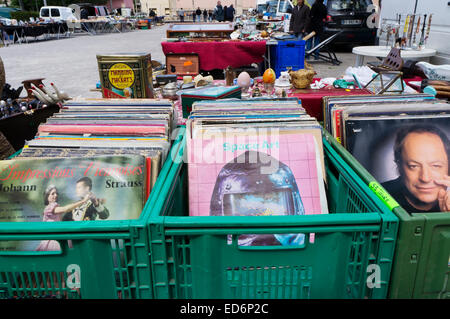 Crates of vinyl records for sale on a market of bric a brac or junk in France. - Stock Photo