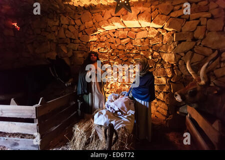 Priscos, Portugal. European largest living or live Nativity Scene. Holy Family, baby Jesus Christ, Mary and Joseph - Stock Photo