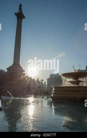 London, UK. 30th December, 2014. Frosty night leaves ice on the fountains in Trafalgar Square after sunrise. Credit: - Stock Photo
