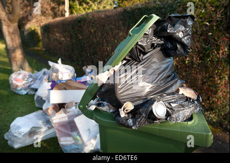 build up of household rubbish refuge causing blockage and pile up of waste preventing access for disabled on council - Stock Photo