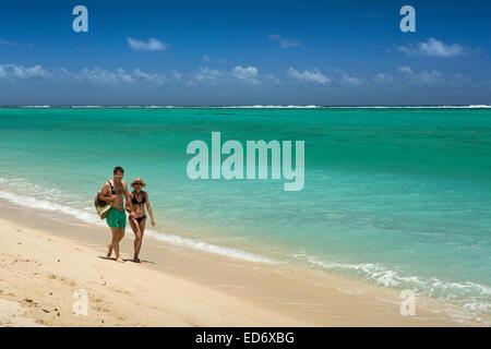 Mauritius, Le M orne, Le Morne beach, woman young couple walking along shoreline - Stock Photo