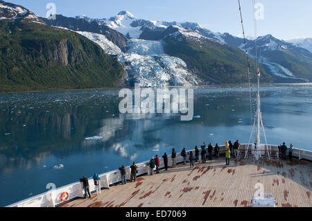 USA, Alaska, Prince William Sound, College Fiord, tourists on cruise ship viewing glaciers - Stock Photo