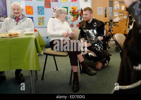 Edinburgh, UK. 30th December, 2014.  Up Helly Aa Vikings visit veterans charity Erskine Edinburgh Home  to sing - Stock Photo
