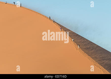 Ascending Dune 45 Sossusvlei Namib-Naukluft National Park Namibia - Stock Photo