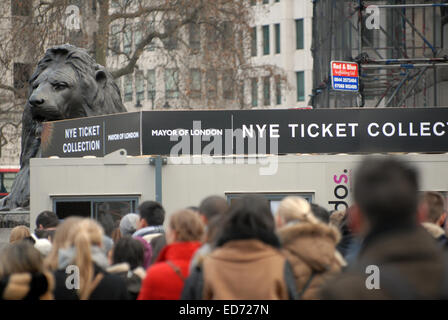 London, UK. 30th December, 2014. Crowds queued on Trafalgar Square to collect tickets for the New Year's Eve fireworks - Stock Photo