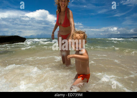 Mother playing with her daughter in a Virgin beach on the waterfront of Ream National Park. Cambodia. Ream National - Stock Photo