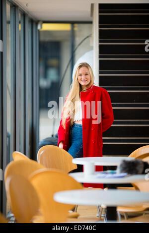 Blonde Teenager Woman Wearing Red Bikini Smelling