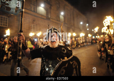 Edinburgh, UK. 30th December 2014. Thousands gather in the center of Edinburgh for the Hogmany Torchlight Procession - Stock Photo