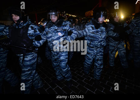 Moscow, Russia. 30th Dec, 2014. Russian riot police push protesters at Manezhnaya square in Moscow, Russia, on Dec. - Stock Photo