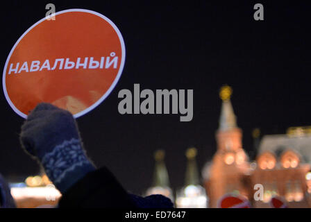 Moscow. 30th Dec, 2014. An Alexei Navalny's supporter holds a banner with Navalny's name at Manezhnaya Square in - Stock Photo