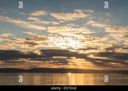 Sunset illuminates clouds over Poole Bay near Bournemouth Dorset UK - Stock Photo