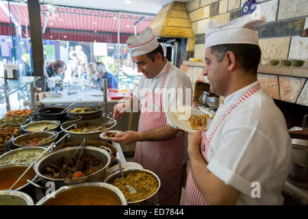 Chefs at Ciya Sofrasi Turkish restaurant serving Ottoman specialities in Kadikoy district Asian side Istanbul, East - Stock Photo