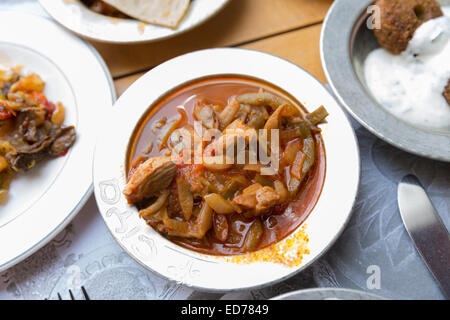 Lamb bean stew plate at Ciya Sofrasi Turkish restaurant in Kadikoy district Asian side of Istanbul, East Turkey - Stock Photo