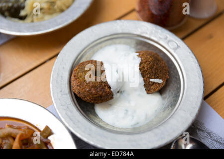Falafel yoghurt plate at Ciya Sofrasi Turkish restaurant in Kadikoy district Asian side Istanbul, East Turkey - Stock Photo