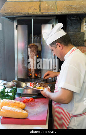 Chef at Ciya Sofrasi Turkish restaurant serving lamb doner kebab in Kadikoy district Asian side Istanbul, East Turkey - Stock Photo