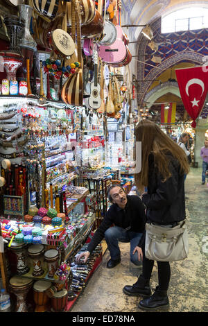 Young woman tourist shopping in The Grand Bazaar, Kapalicarsi, great market in Beyazi, Istanbul, Republic of Turkey - Stock Photo