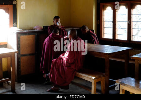 Buddhist novices in the dining room of the Tamshing Lakhang temple formally the Tamshing Lhendup Chholing (Temple - Stock Photo