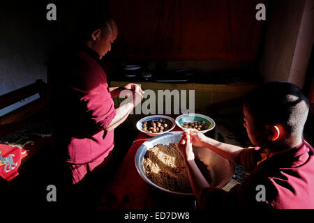Young Buddhist novices preparing food at the Tamshing Lakhang temple formally the Tamshing Lhendup Chholing (Temple - Stock Photo
