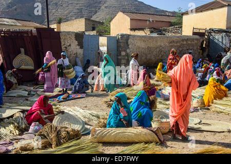 Women selling their goods on the colourful Monday market of Keren, Eritrea - Stock Photo
