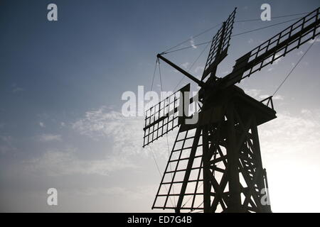 Windmill silhouetted against the morning sky - Stock Photo