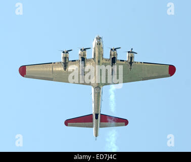 Heavy World War II era Flying Fortress bomber flying overhead - Stock Photo